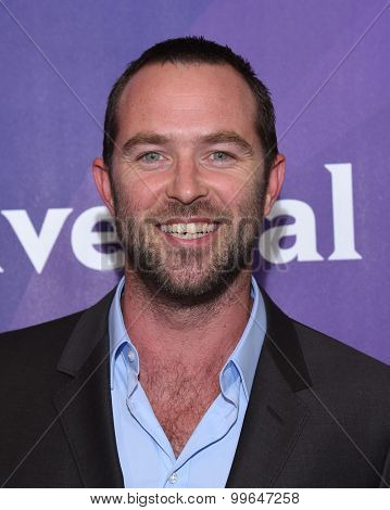 LOS ANGELES - AUG 12:  Sullivan Stapleton arrives to the arrives to the Summer 2015 TCA's - NBCUniversal  on August 12, 2015 in Beverly Hills, CA