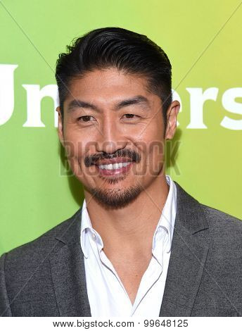 LOS ANGELES - AUG 13:  Brian Tee arrives to the Summer 2015 TCA's - NBCUniversal  on August 13, 2015 in Hollywood, CA