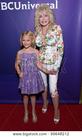 LOS ANGELES - AUG 13:  Dolly Parton & Alyvia Lind arrives to the Summer 2015 TCA's - NBCUniversal  on August 13, 2015 in Hollywood, CA