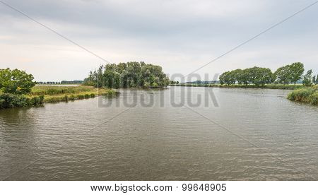 Overlooking A Small Lake On A Cloudy Summer Day