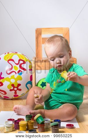 Kid Trying To Draw A Colorful Old Paints Isolated On White