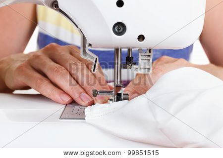Women's Hands Behind Her Sewing
