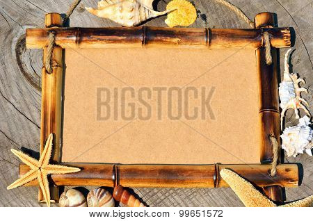 Frame Decorated With Shells On Wooden Background