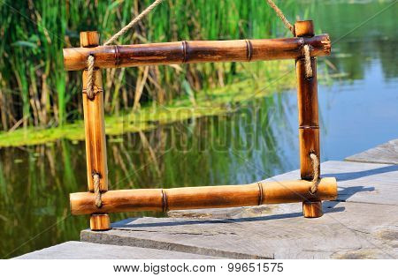 Bamboo Frame On The River Background