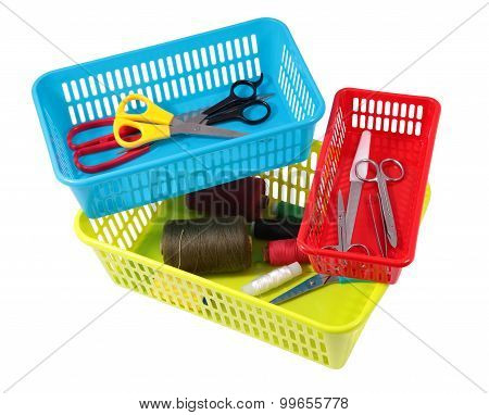 Multi-colored Plastic Boxes Of Different Sizes For Storing Household Tools.