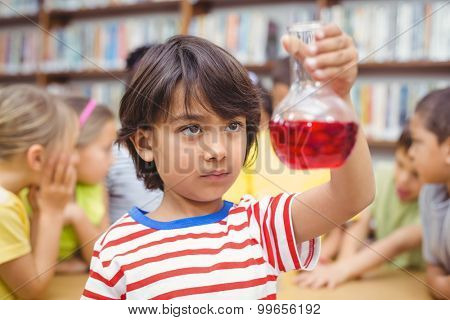 Pupil doing science in library at the elementary school