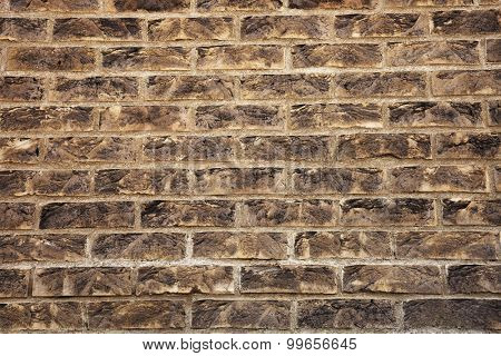 Grungy textured brown brick wall. Masonry brickwork concept.