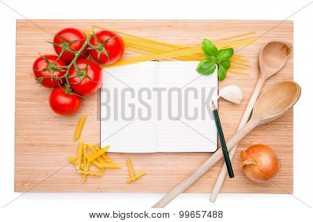 Cookery Book Arranged On Wooden Board With Different Ingredients