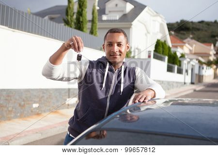 Cheerful boy with keys in hand of her new car