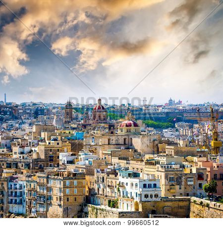 beautiful view on houses and roofs of Valletta at sunset in Malta from high