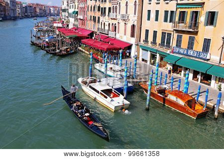 VENICE, ITALY - SEPTEMBER 2014 : Gondolas, public boats, water taxis and other private boats navigating the Grand Canal in Venice, Italy on September 15, 2014.