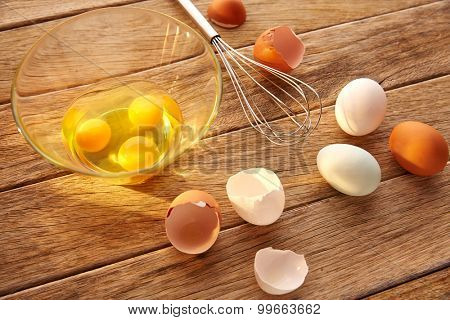 Eggs and shaker on wood with blue easter white and brown egg colors