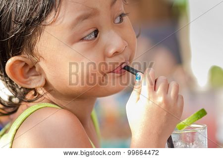 Cute Asian Child Enjoy Drinking Iced Lemonade