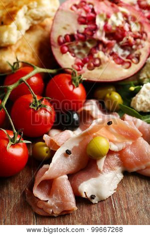 Ingredients of Mediterranean cuisine, on wooden board background