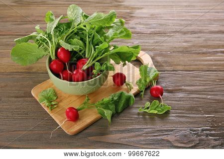 Fresh red radish on wooden background