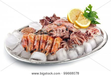 Seafood with lemon and ice on metal tray isolated on white