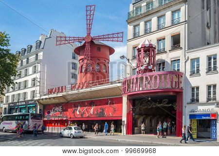 PARIS - JUN 22: The Moulin Rouge  on June 22, 2014 in Paris, France. Moulin Rouge is a famous cabaret built in 1889, located in the Paris red-light district of Pigalle.