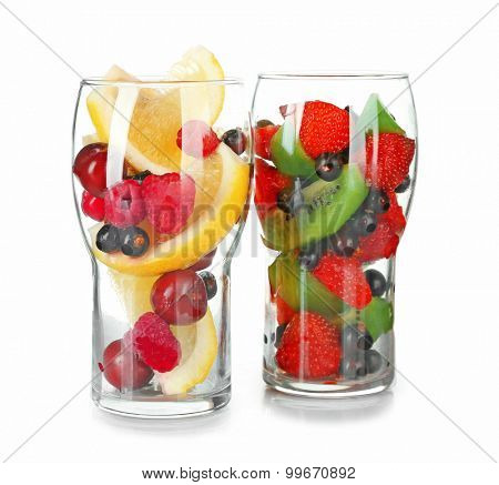 Glasses of berries and fruits isolated on white