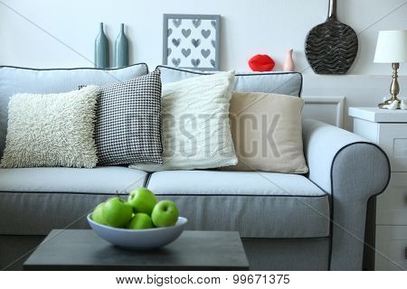 Beautiful modern living room with grey sofa