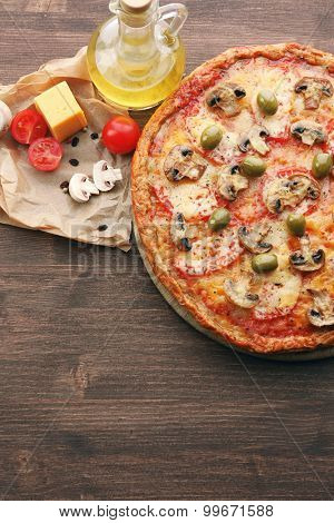 Tasty pizza with vegetables and cheese on table close up