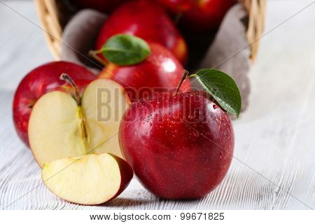 Ripe red apples on table close up
