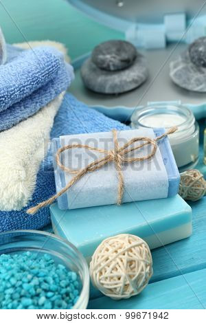 Spa stones and spa treatments on color wooden background