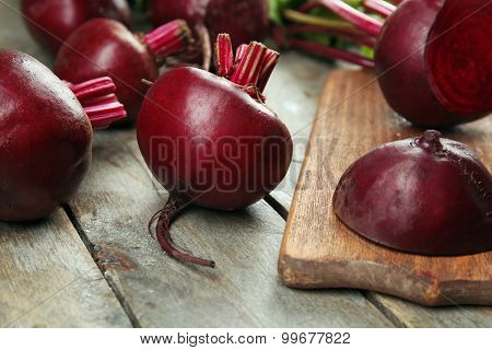 Young beets on wooden table close up