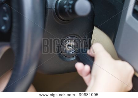 Female Hand Putting Key In Car.