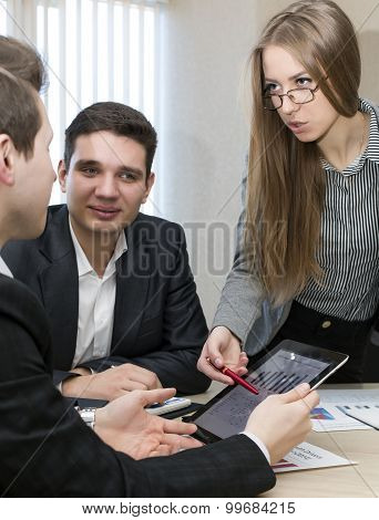 Serious female manager explains corporate data to her associate