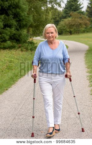 Middle Aged Woman Walking With Two Canes