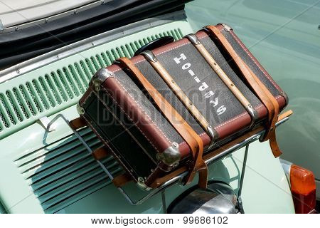 Suitcase Strapped To A Vintage Car