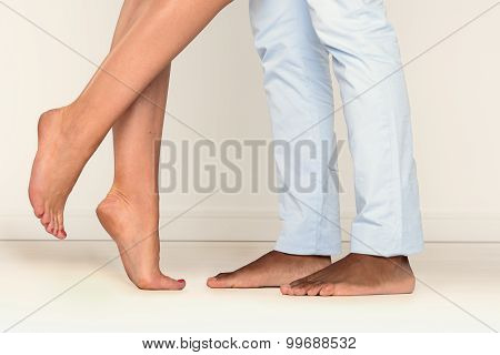 Barefoot Man And Woman On Tiptoe