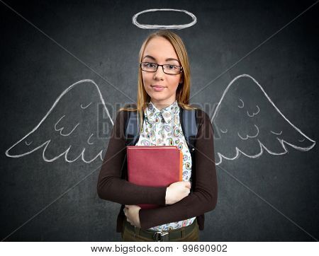 schoolgirl with funny angel wings and nimbus