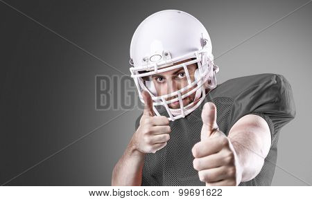 Football Player on gray uniform on gray background