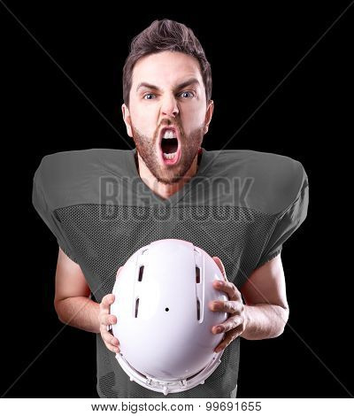Football Player on gray uniform isolated on black background