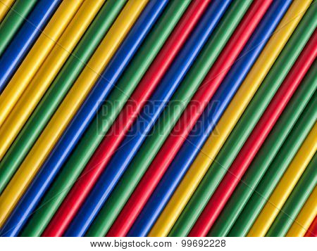 Colorful drinking straws arranged in diagonal straight lines
