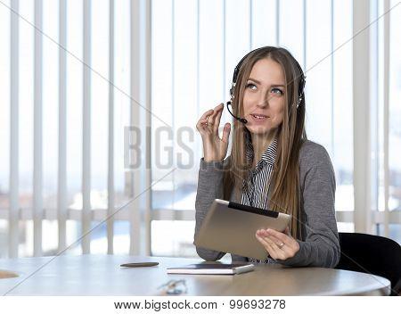 Dreaming female customer support officer