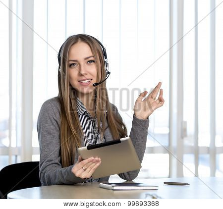 Female customer support officer looking to the camera
