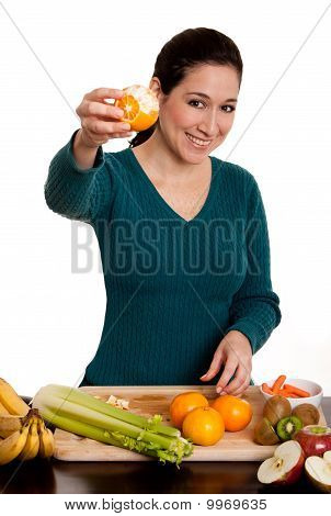 Woman Presenting Peeled Ornage Fruit