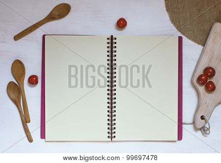 Copy Book And Cherry Sweetmeat On White Table