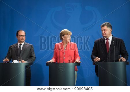 Francois Hollande, Angela Merkel And Petro Poroshenko
