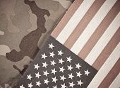 stock photo of camo  - Military Theme Background With Camo And American Flag - JPG