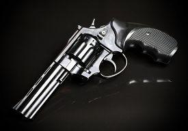 picture of revolver  - Revolver gun on black background - JPG