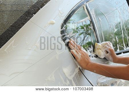 Woman Hand Hold Sponge Washing Car