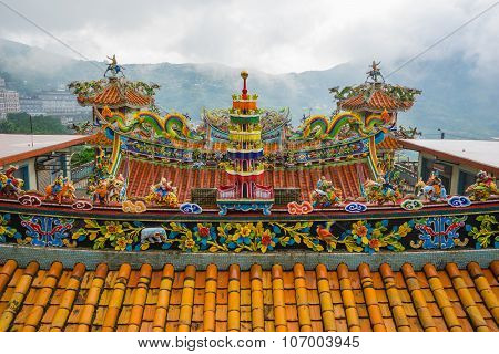 Decoration On The Roof Of Quanji Temple, Jiufen, Taiwan.  The Temple With The Largest Statue Of Guan