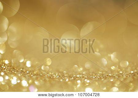 Abstract golden shiny glitter bokeh christmas background