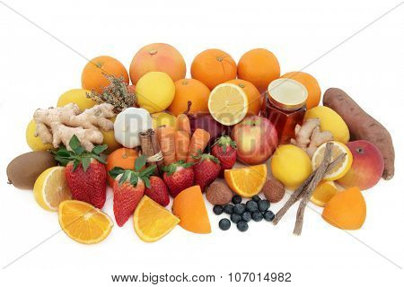 Large super food selection for cold and flu remedy including foods high in vitamin c antioxidants over white background.