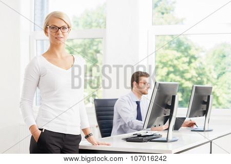 Beautiful female ceo keeping everything under control in the office