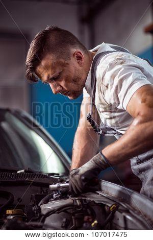 Handsome Mechanic Working