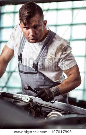 Mechanic Fixing Car Problem